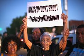 Ferguson, Mo. residents protesting the police shooting of unarmed Mike Brown. - courtesy of NBC News